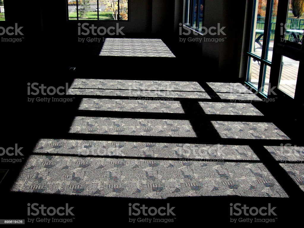 LONG SHADOWS ON CARPET stock photo