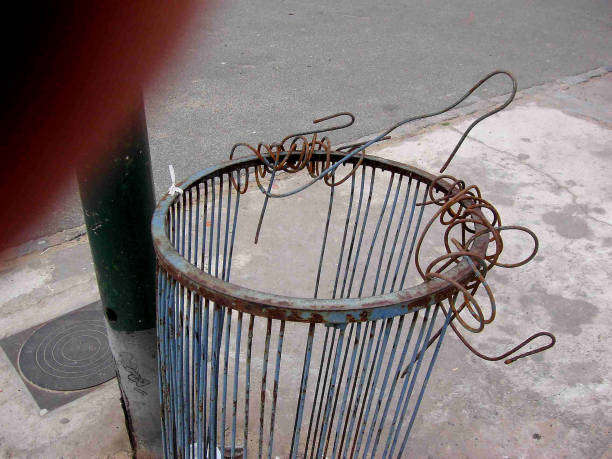 BENT WIRE TRASH CAN stock photo