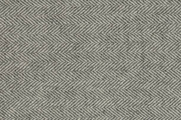astral herringbone coal fabric texture - chevron stock photos and pictures
