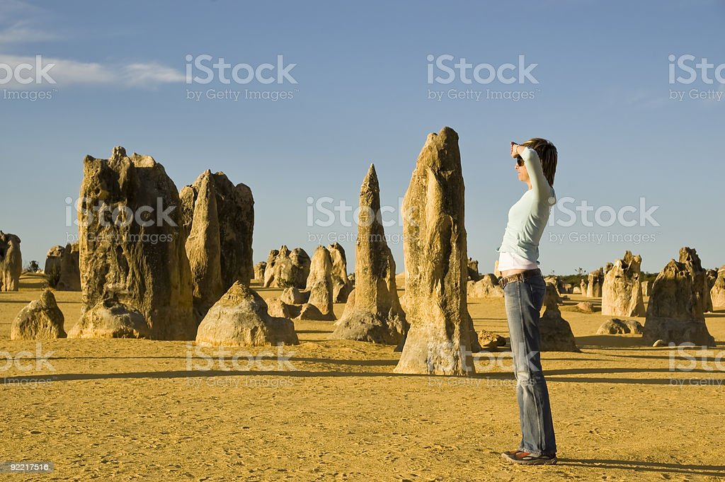 WOMAN IN THE PINNACLES DESERT stock photo