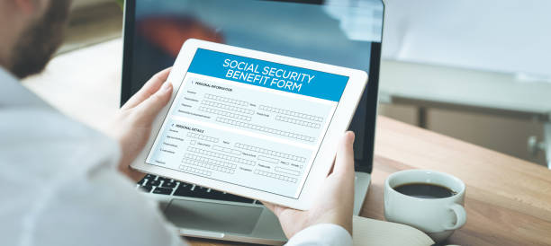 social security benefit form concept - apply online stock photos and pictures