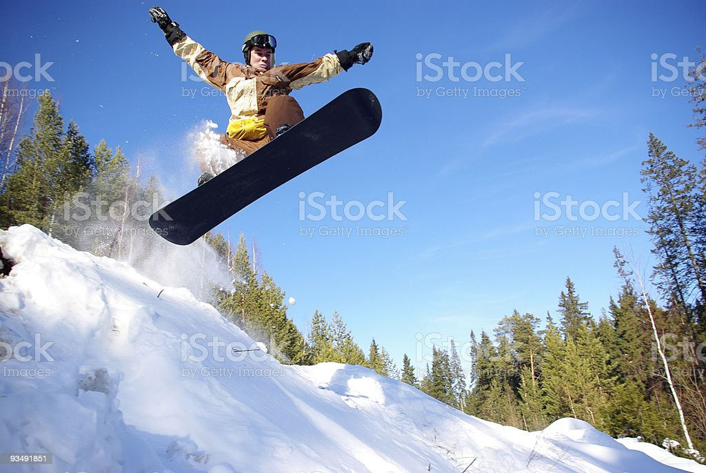 SNOWBOARDER JUMPING royalty-free stock photo
