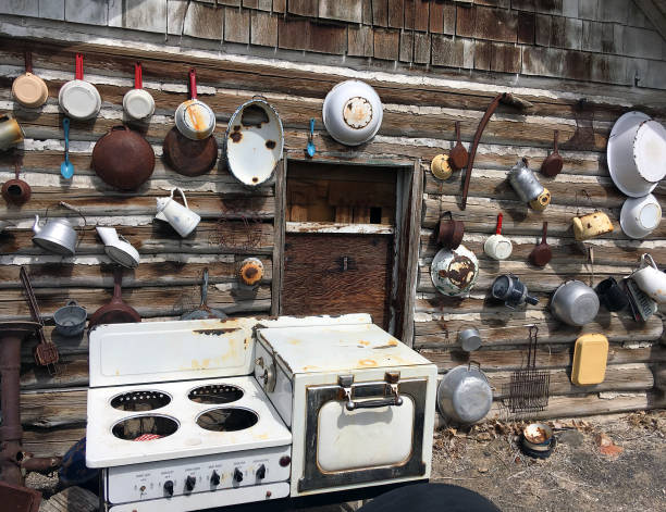LOG CABIN EXTERIOR WITH POTS AND PANS stock photo
