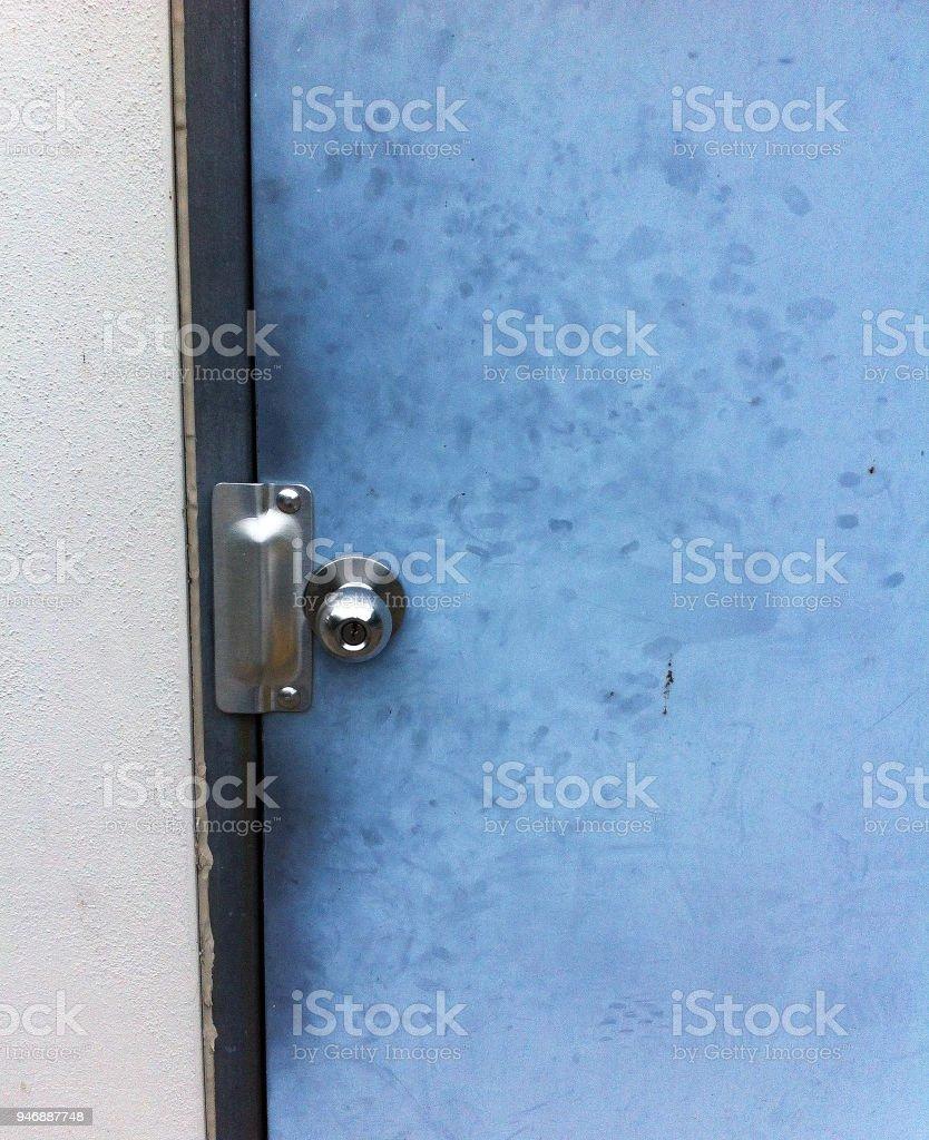 FINGERPRINTS ON DIRTY DOOR stock photo