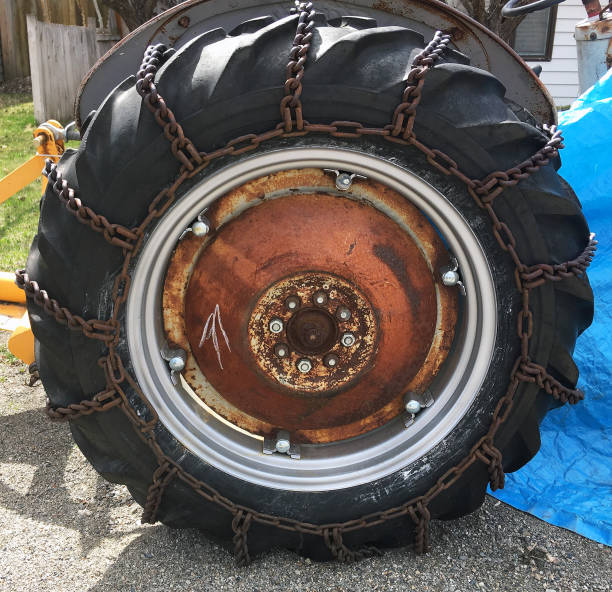 TRACTOR WHEEL WITH CHAINS stock photo