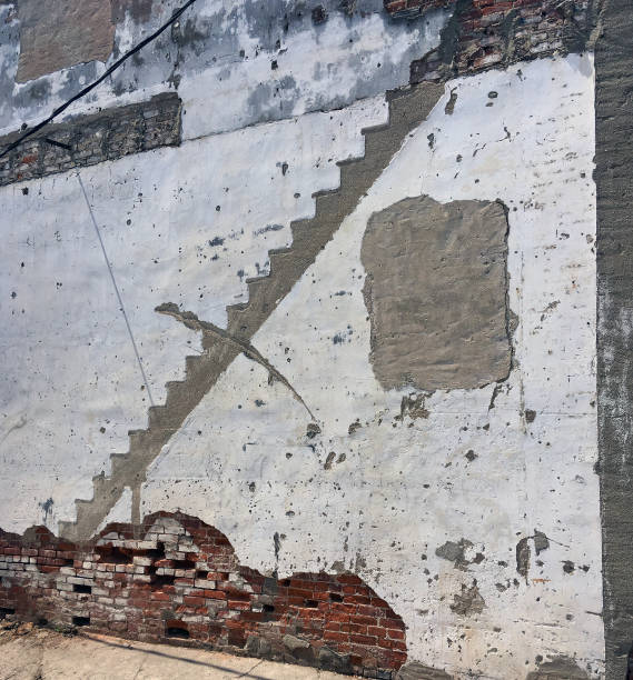 SILHOUETTE OF DEMOLISHED STAIRCASE stock photo