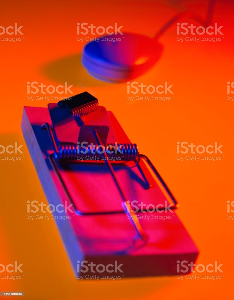 MOUSE TRAP WITH COMPUTER CHIP AS BAIT ATTRACTING COMPUTER MOUSE stock photo