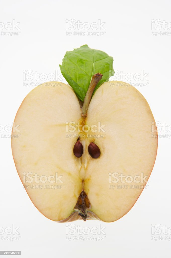 FRESH APPLE SLICED IN HALF ON WHITE BACKGROUND - Royalty-free Agriculture Stock Photo