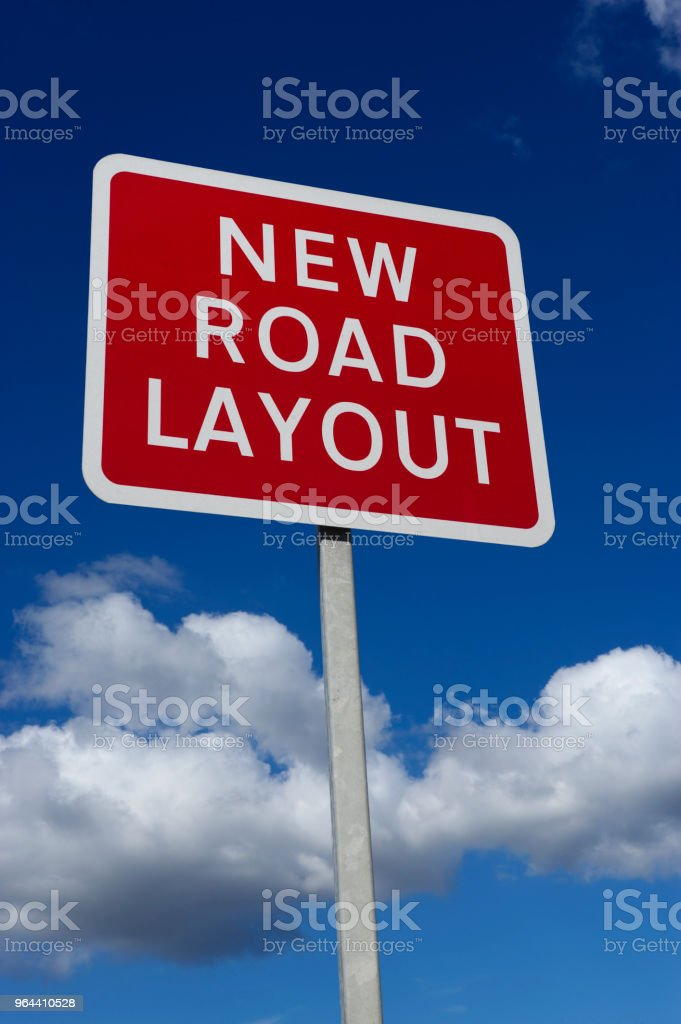 RED NEW ROAD LAYOUT SIGN - Royalty-free Blue Stock Photo