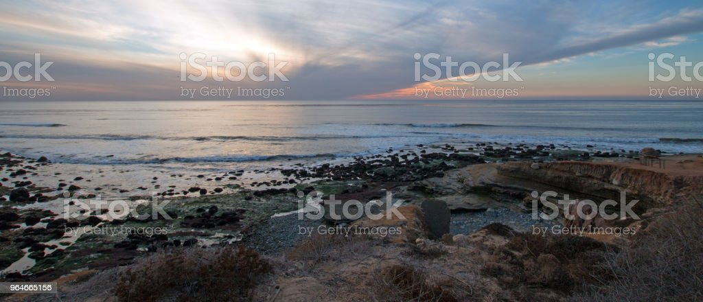 TWILIGHT SUNSET ON POINT LOMA TIDEPOOLS AT CABRILLO NATIONAL MONUMENT IN SAN DIEGO IN SOUTHERN CALIFORNIA UNITED STATES royalty-free stock photo