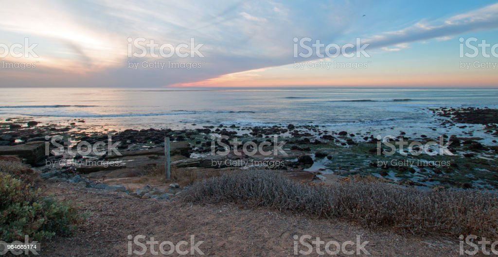 SUNSET CLOUDSCAPE ON POINT LOMA TIDEPOOLS AT CABRILLO NATIONAL MONUMENT IN SAN DIEGO IN SOUTHERN CALIFORNIA UNITED STATES royalty-free stock photo