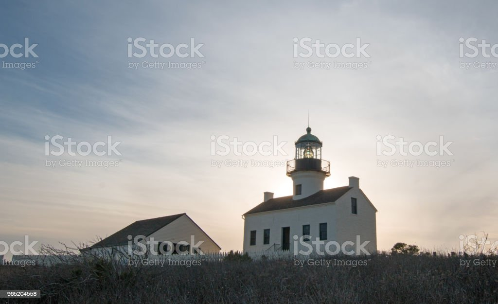 SUNSET BACKLIGHTING ON OLD POINT LOMA LIGHTHOUSE POINT LOMA SAN DIEGO CALIFORNIA USA royalty-free stock photo