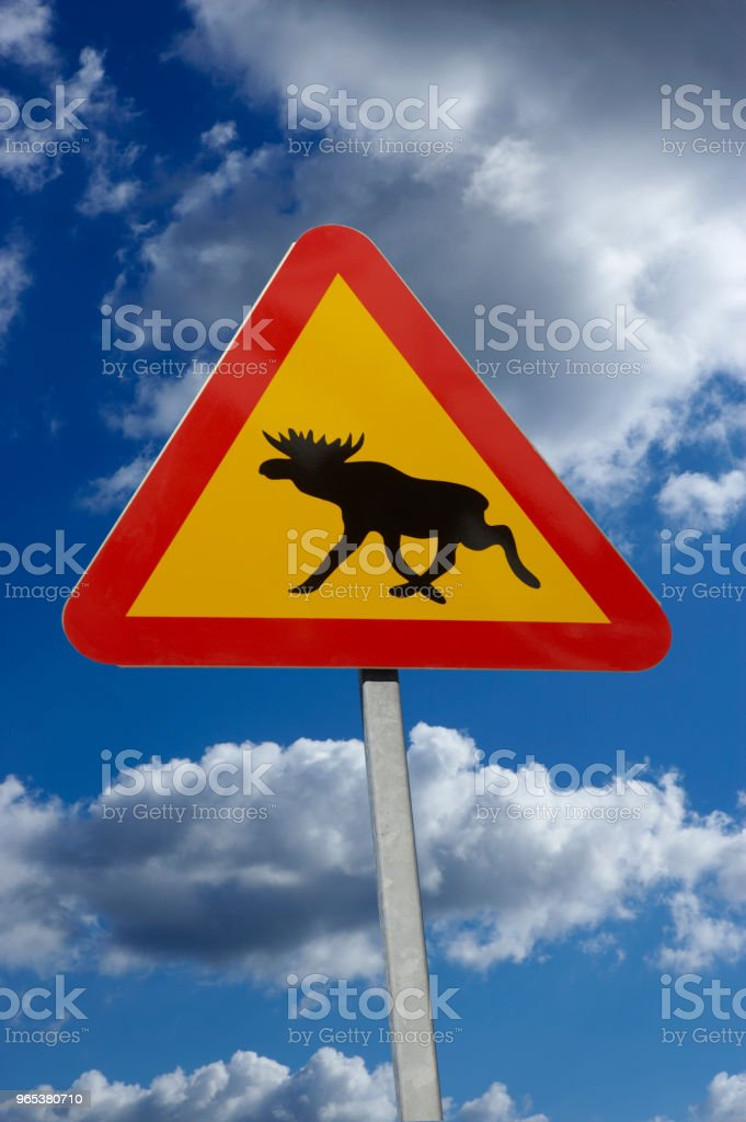 RED AND YELLOW MOOSE TRAFFIC SIGN AND BLUE SKY AND CLOUDS zbiór zdjęć royalty-free