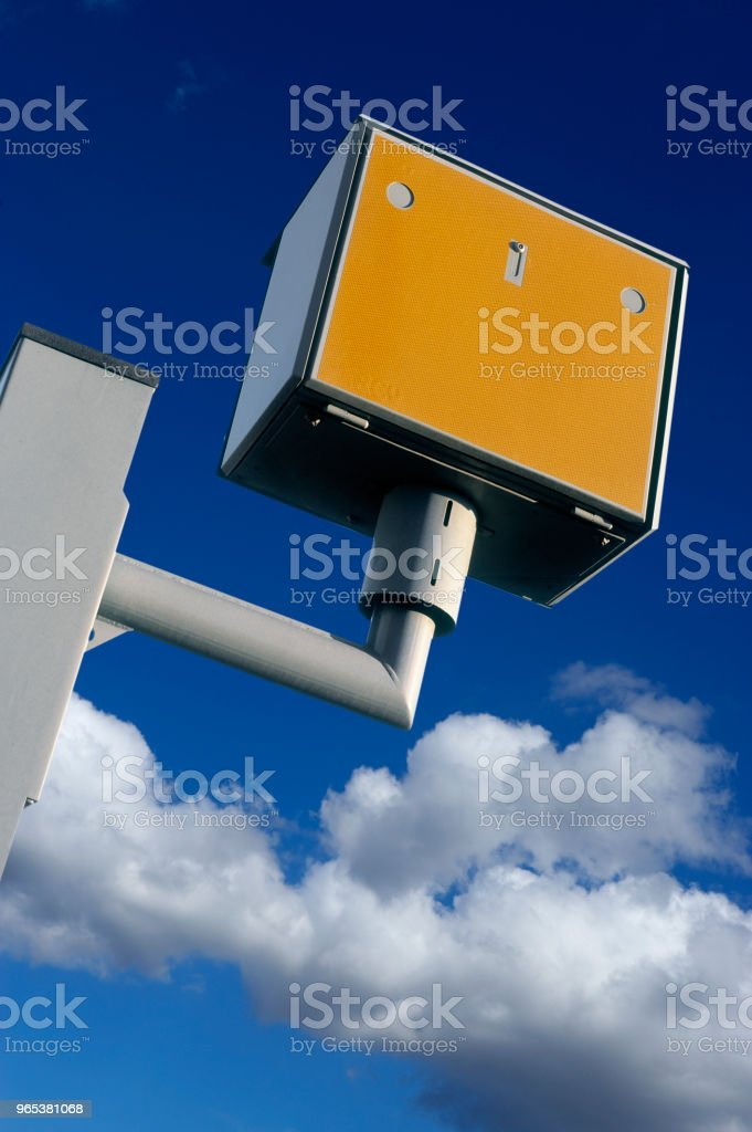 YELLOW SPEED CAMERA WITH BLUE SKY royalty-free stock photo