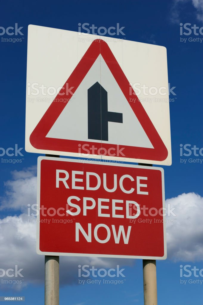 ROAD TRAFFIC REDUCE SPEED NOW SIGN zbiór zdjęć royalty-free