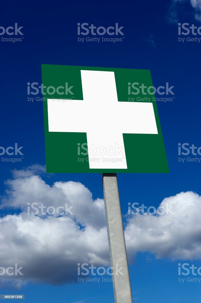 ROAD TRAFFIC FIRST AID WARNING SIGN WITH BLUE SKY AND CLOUDS zbiór zdjęć royalty-free