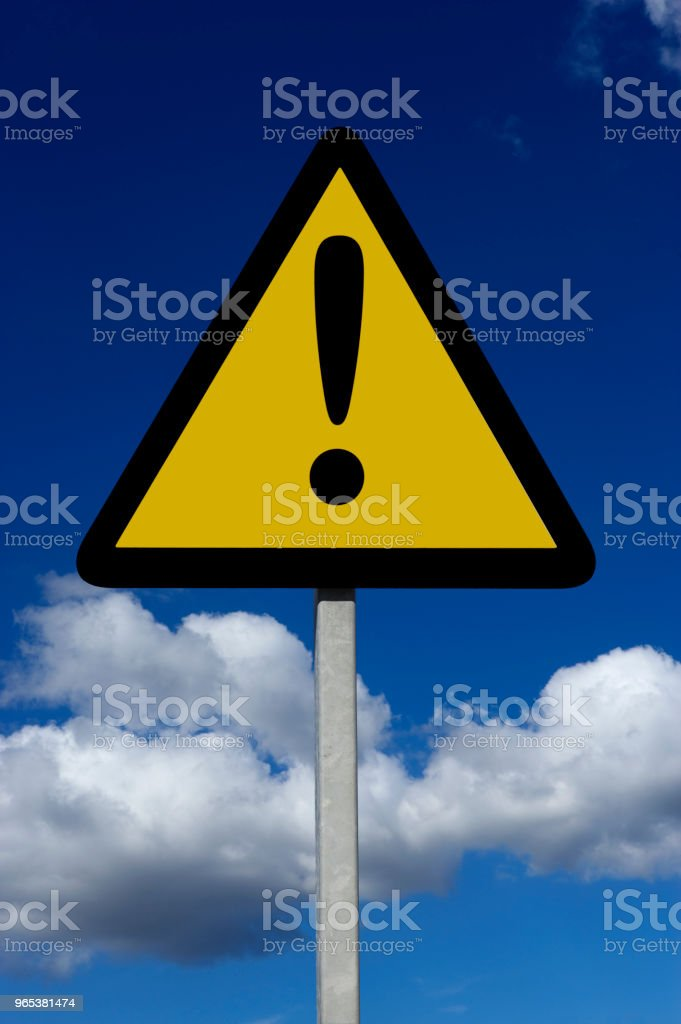 YELLOW TRIANGULAR WARNING SIGN royalty-free stock photo