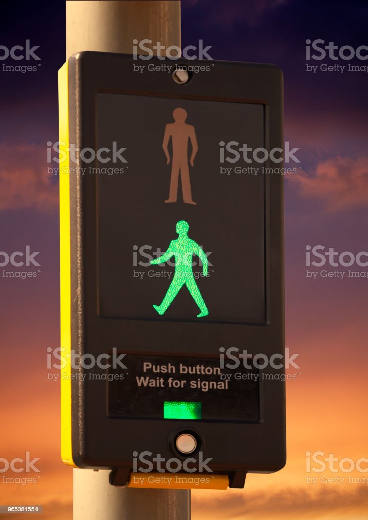 PEDESTRIAN CROSSING CONTROL BOX WITH TWILIGHT SKY royalty-free stock photo