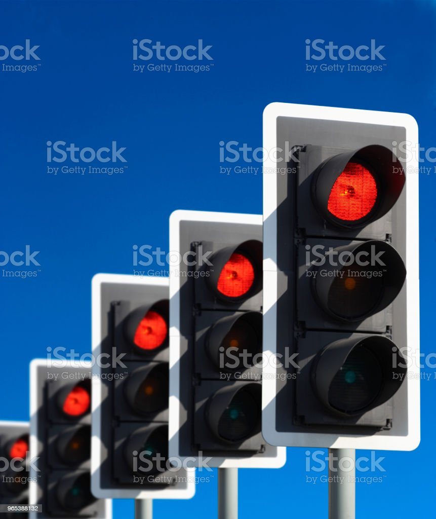 FIVE TRAFFIC LIGHTS SHOWING RED royalty-free stock photo