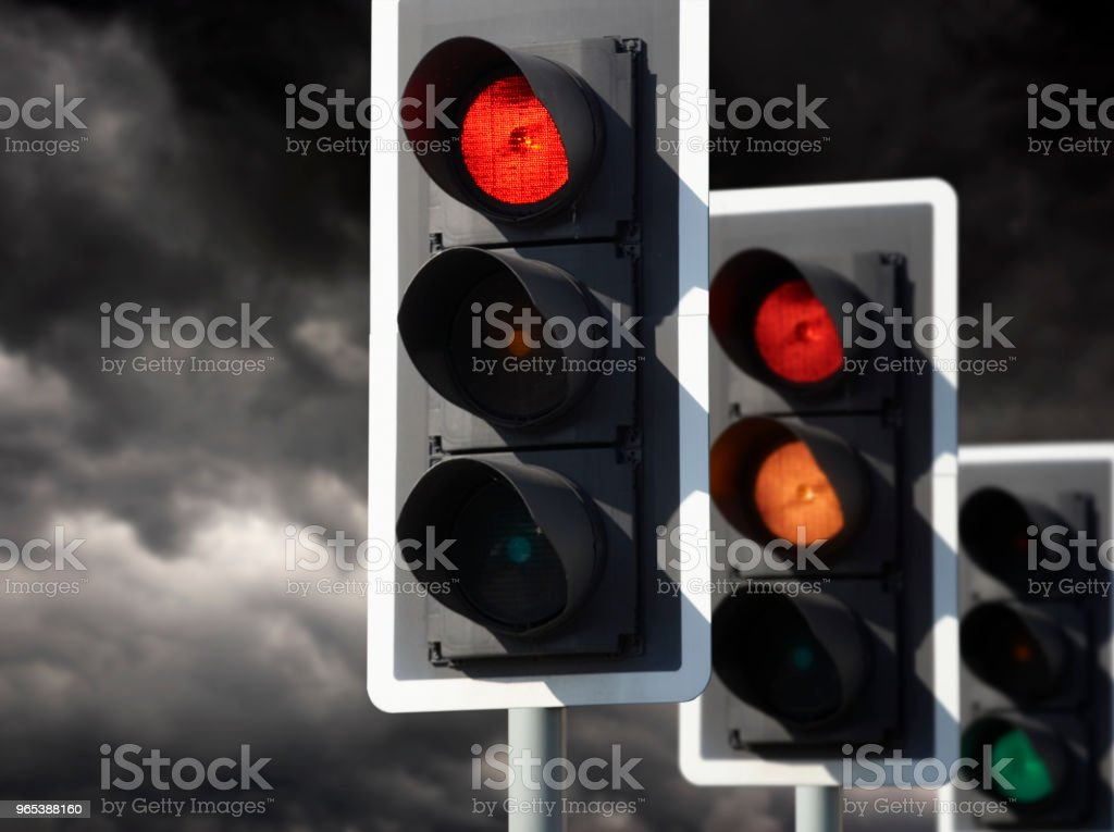 THREE TRAFFIC LIGHTS SHOW RED AMBER GREEN royalty-free stock photo