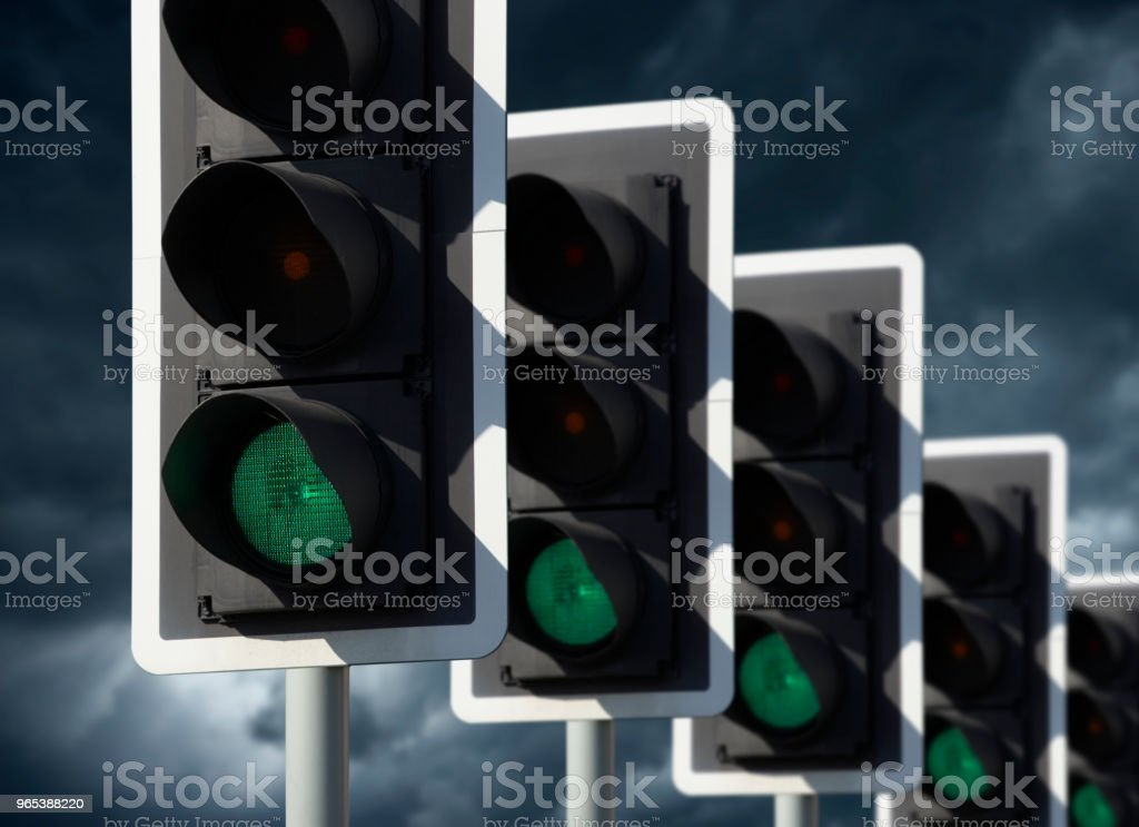 FIVE ROAD TRAFFIC LIGHTS SHOWING GREEN royalty-free stock photo