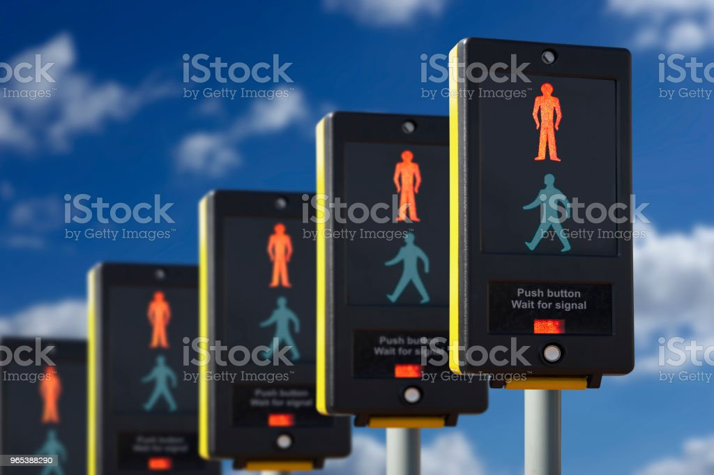 FIVE PEDESTRIAN CROSSING LIGHTS SHOWING RED royalty-free stock photo