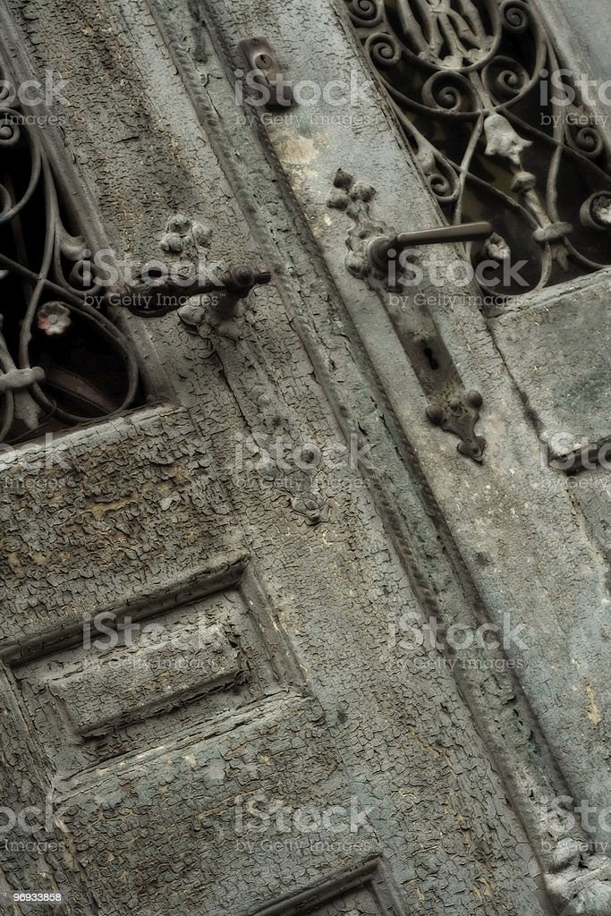 WEATHERBEATEN OLD DOOR royalty-free stock photo