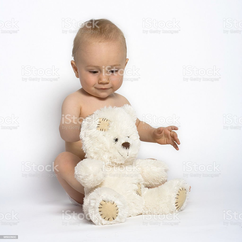CUTE INFANT WITH TEDDY BEAR royalty-free stock photo