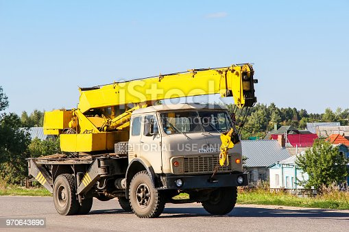 Suzdal, Russia - August 23, 2011: Mobile crane MAZ 5335 in the city street.