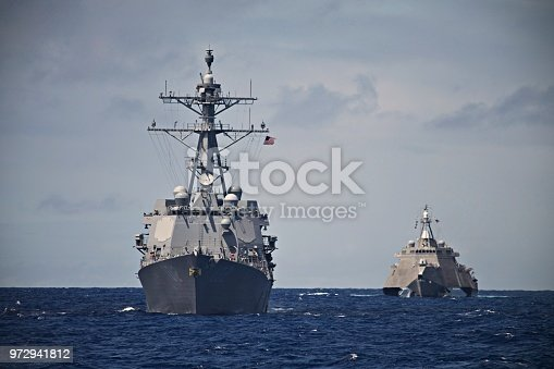 A USS Destroyer and Littoral Combat Ship hunt together in the South Pacific. Taken during a Pacific Deployment in 2014.