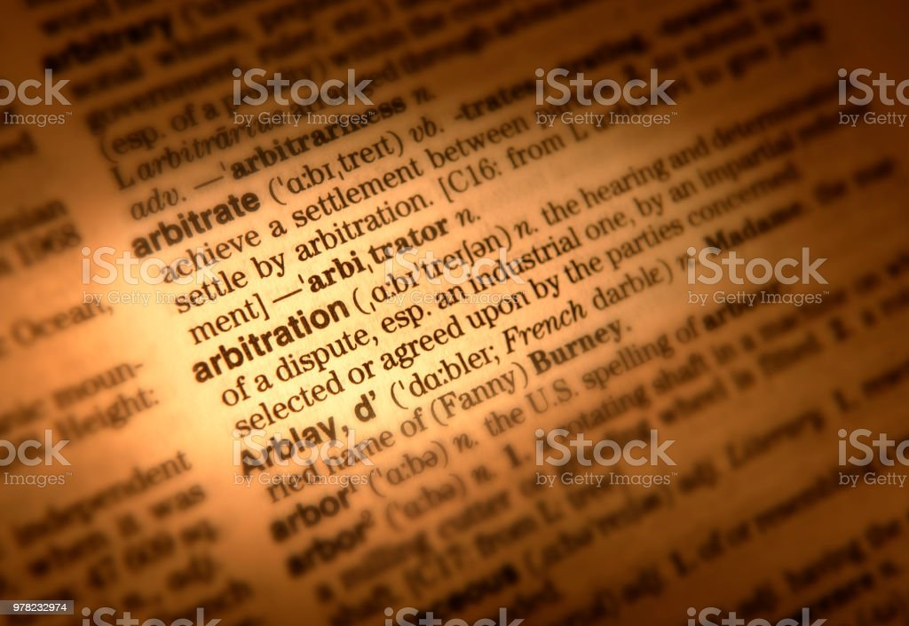 DICTIONARY PAGE SHOWING DEFINITION OF THE WORD ARBITRATION stock photo
