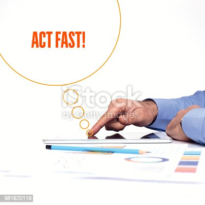 istock BUSINESSMAN WORKING OFFICE  ACT FAST! COMMUNICATION TECHNOLOGY CONCEPT 981620116
