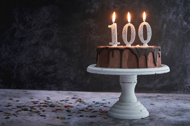 100th Birthday Cake 100th Birthday Cake with Chocolate 100th anniversary stock pictures, royalty-free photos & images