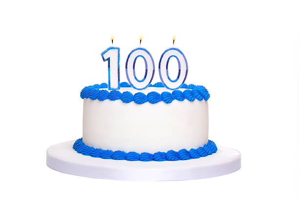 100th birthday cake Birthday cake with candles reading 100 100th anniversary stock pictures, royalty-free photos & images