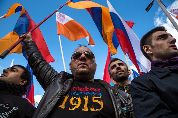 100th of Armenian genocide Russia, Moscow, 24 of April 2015:  People holding a Armenian flags in Moscow Gorky park to mark the 100th anniversary of the Armenian genocide in the Ottoman Empire on 1915 year  armenian genocide stock pictures, royalty-free photos & images