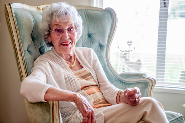 100-Year Old Woman Having a Cheerful Conversation in Her Home 100-Year Old Woman Having a Cheerful Conversation in Her Home 80 89 years stock pictures, royalty-free photos & images