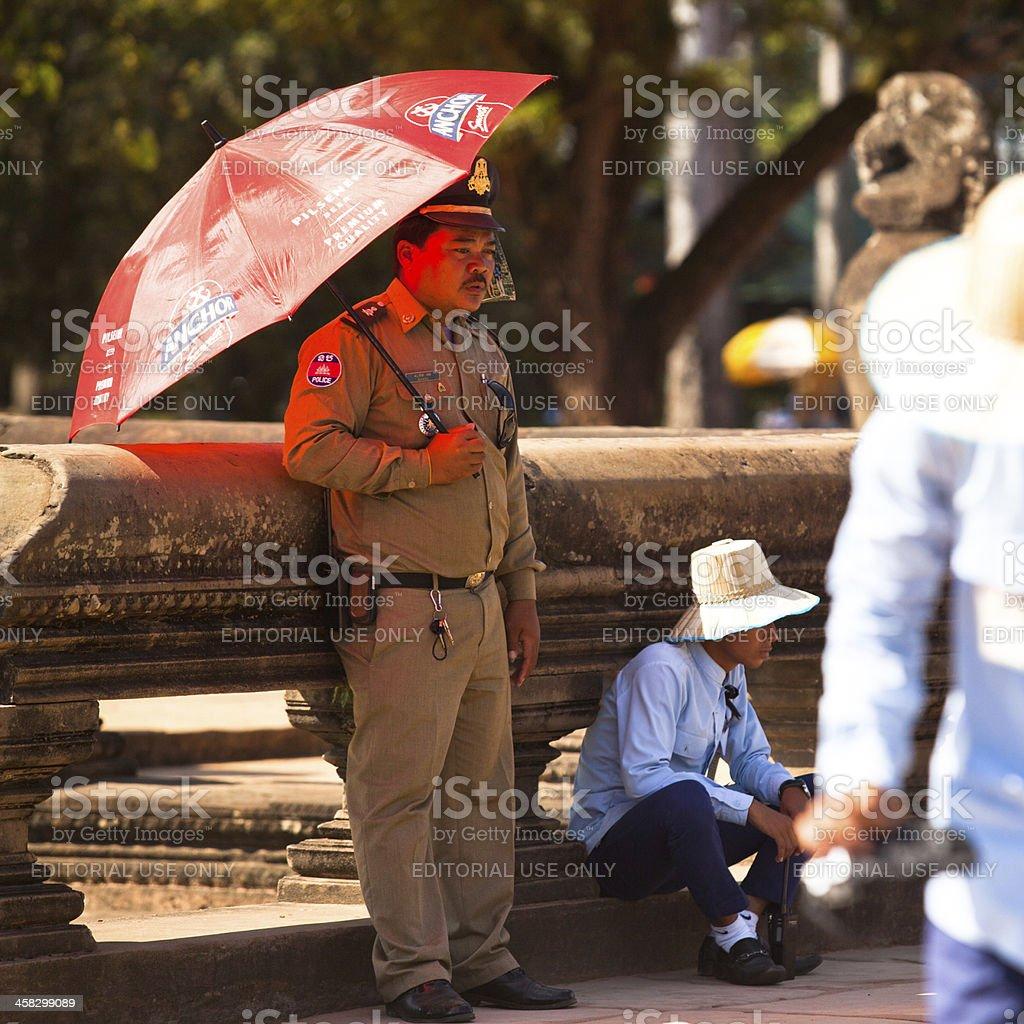 Сambodian policeman in Angkor Wat on Siem Reap, Cambodia. stock photo