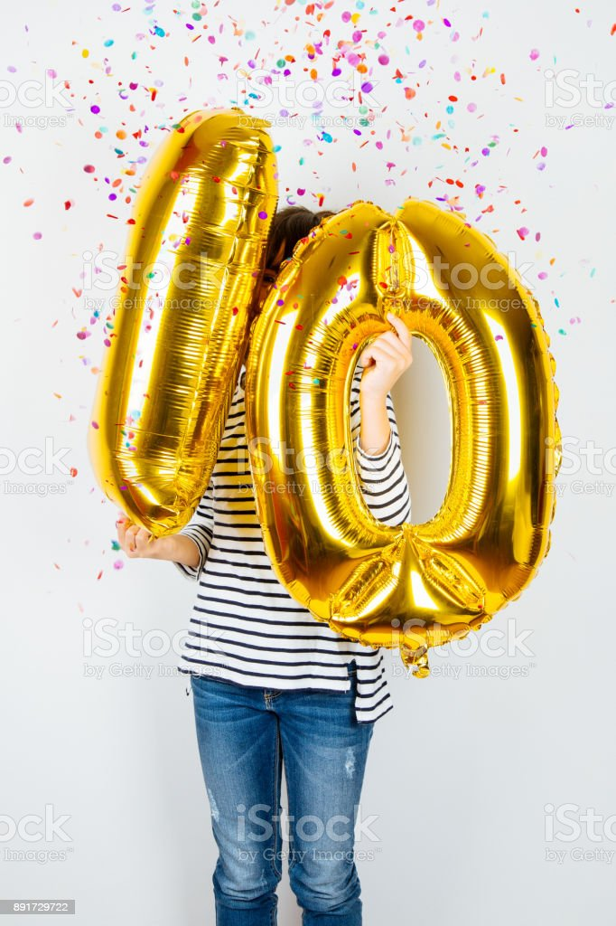 10th anniversary celebration party girl with golden balloons – zdjęcie