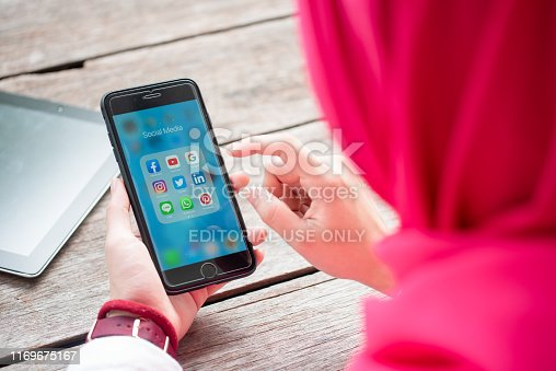 535970955 istock photo BANGKOK, THAILAND- 10th August 2019 : Hands of Islamic woman use Iphone 7 plus with social media application of facebook, youtube, google search, instagram, twitter, linked in, line whatsapp, and pinterest 1169675167
