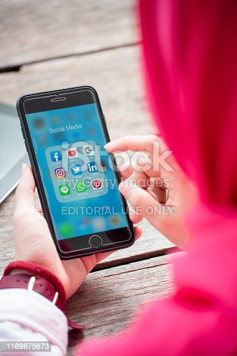 535970955 istock photo BANGKOK, THAILAND- 10th August 2019 : Hands of Islamic woman use Iphone 7 plus with social media application of facebook, youtube, google search, instagram, twitter, linked in, line whatsapp, and pinterest 1169675673