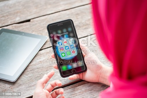535970955 istock photo BANGKOK, THAILAND- 10th August 2019 : Hands of Islamic woman use Iphone 7 plus with social media application of facebook, youtube, google search, instagram, twitter, linked in, line whatsapp, and pinterest 1169675674