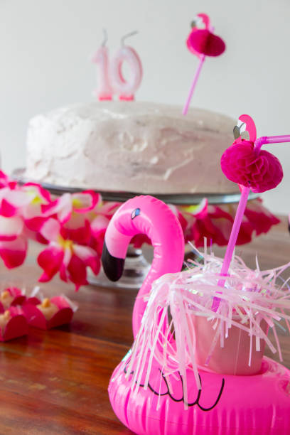 10th birthday cake with marshmallow topping and pink flamingos stock photo