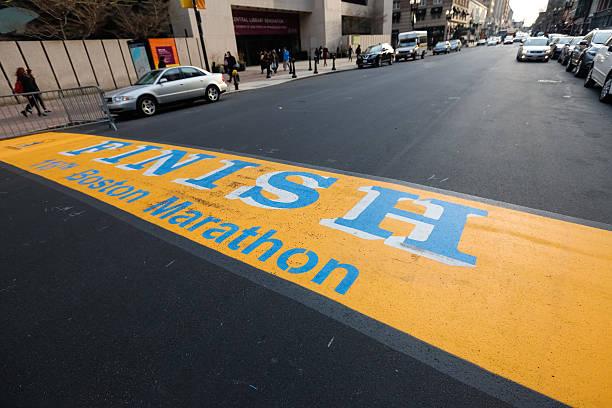 118th boston marathon finish line - boston marathon stock photos and pictures