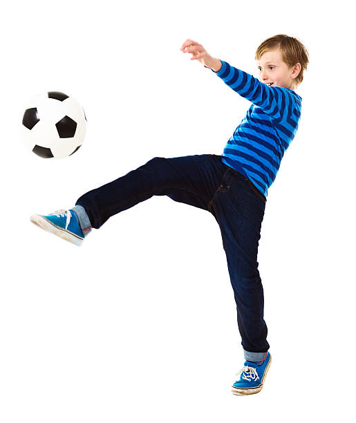 royalty free silhouette of boy kicking soccer ball pictures images