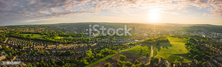 istock 12k Aerial Panorama of Sheffield City, South Yorkshire, UK during Sunset - Spring 2019 1150434847