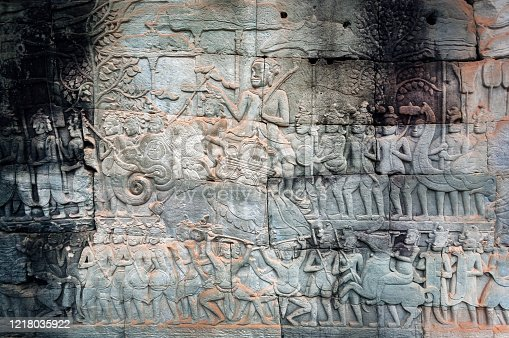 1147569123 istock photo 12th century bas-relief with huge army of Khmer kingdome going to war, inside the Bayon temple, Cambodia. Historical artwork on wall of Southeast Asian landmark. UNESCO world heritage site in Angkor 1218035922