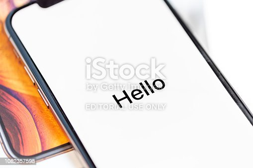 istock 12th October,2018-Kiev,Ukraine: Latest Iphone XS on opened box on white table. Newest Apple smartphone on white branded box in mobile store. Edge frameless screen with loading Hello text 1082357598