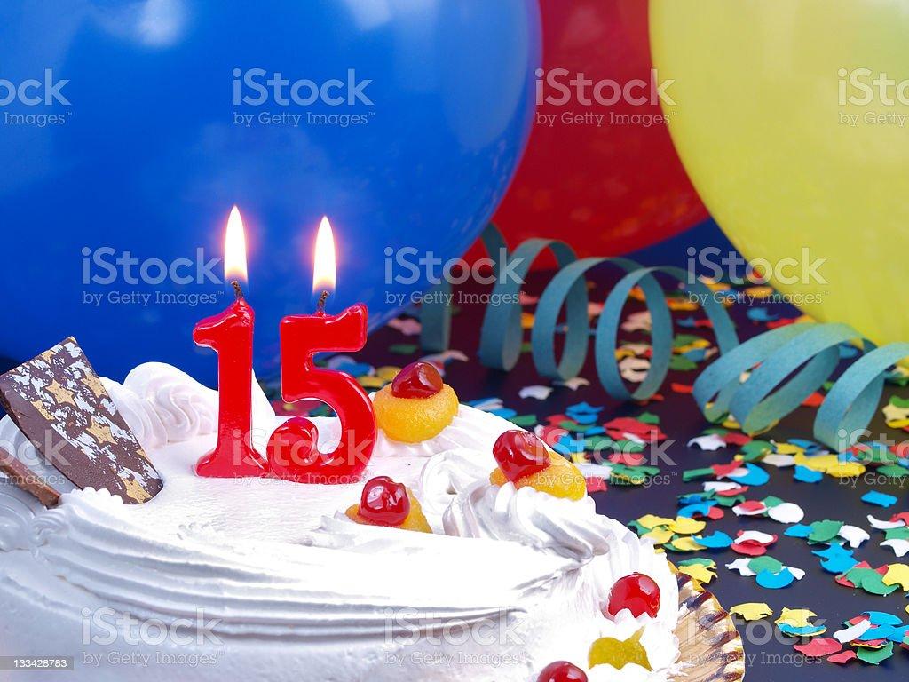 15th anniversary vanilla cake with balloons and confetti stock photo