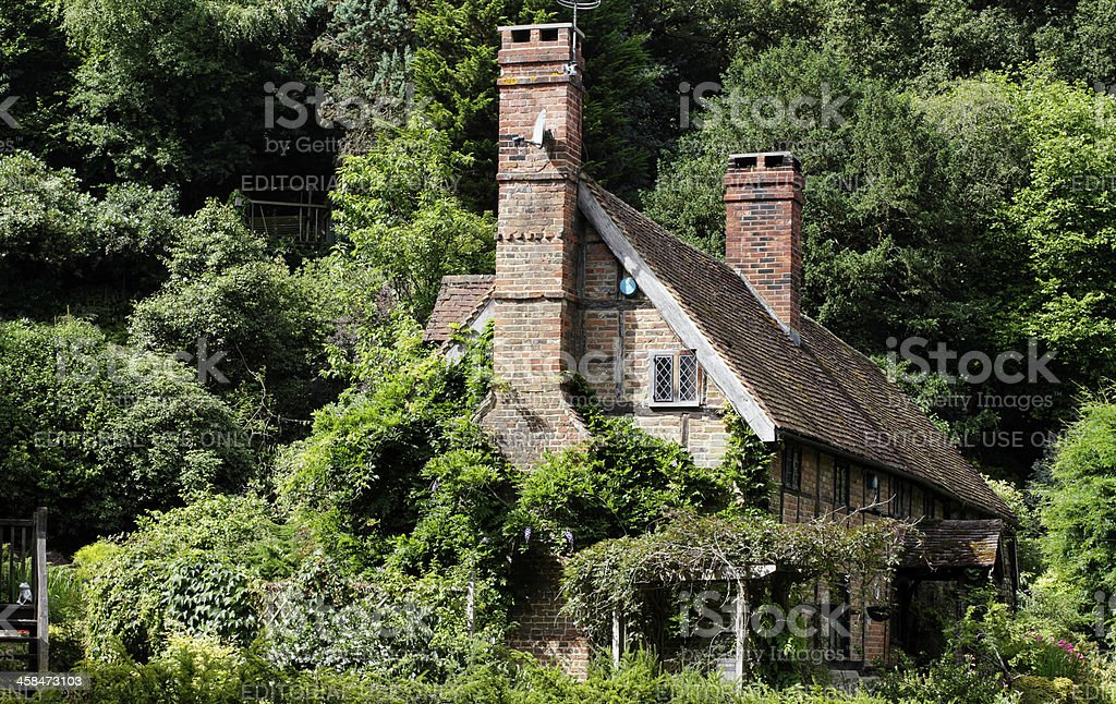16th century red-brick Tudor cottage in the Surrey Hills royalty-free stock photo