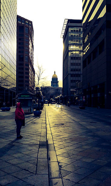 16th street denver colorado december early morning bus stop woman - colorado state capitol stock photos and pictures